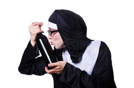 Nun with bottle of wine on white