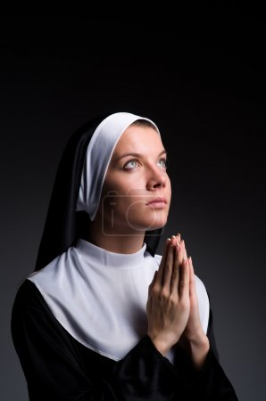 Young nun in religious concept...