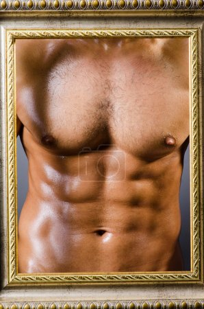 Photo for Muscular man with picture frame - Royalty Free Image