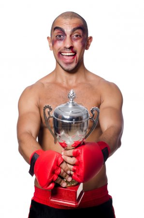 Badly beaten boxer with prize