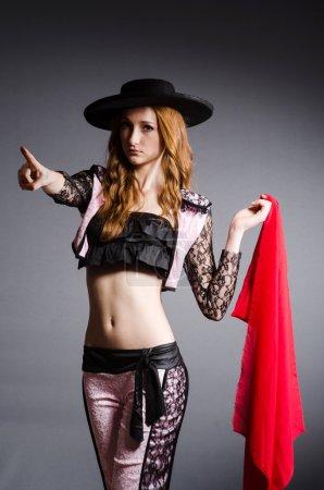 Redhead woman toreador