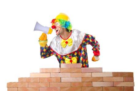 Clown laying bricks