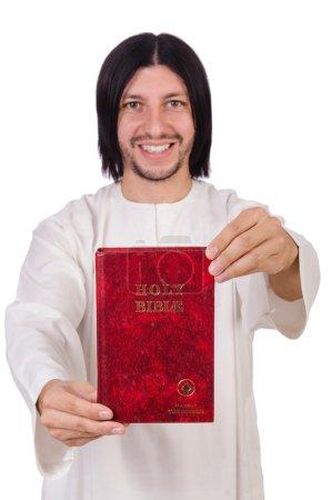Photo pour Jeune prêtre avec bible isolé sur blanc - image libre de droit