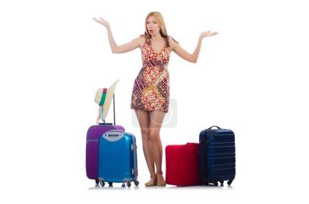 Photo pour Femme se préparant pour les vacances avec valise isolée sur blanc - image libre de droit