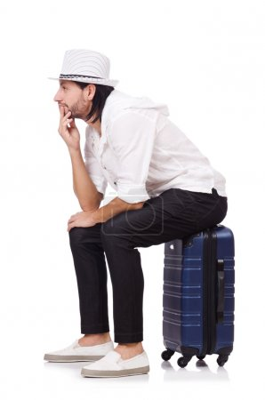 Travel vacation concept with luggage on white...