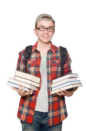 Photo pour Étudiant drôle avec pile de livres - image libre de droit