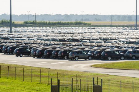 New cars parked at distribution center