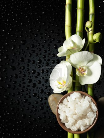 Photo for Bowl of salt and orchid, bamboo on black - Royalty Free Image