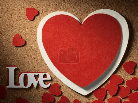 """Photo for Holidays card with heart as a symbol of love, valentines day card with word """"love"""" and heart - Royalty Free Image"""