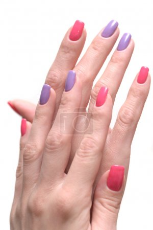 Women's hands with a colored nail polish (manicure).