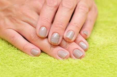 Woman hands with manicured  nails