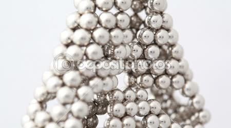 Magnet balls in triangular structure with holes