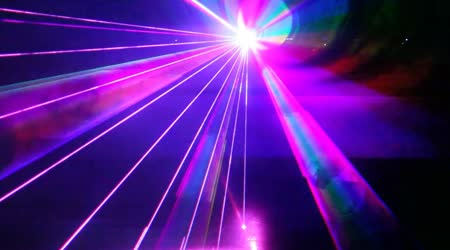 Multi-colored laser beams move in dark proceeding from one point