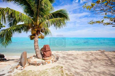 Polynesian statue on the beach
