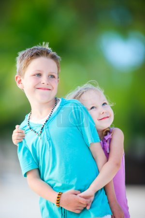Photo for Brother and little sister outdoors laughing - Royalty Free Image