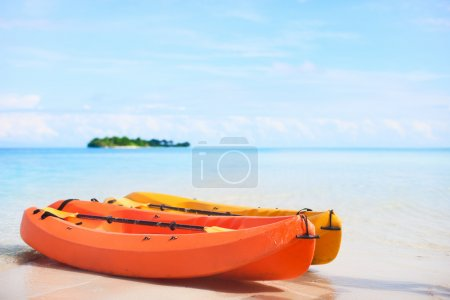 Two kayaks at tropical beach