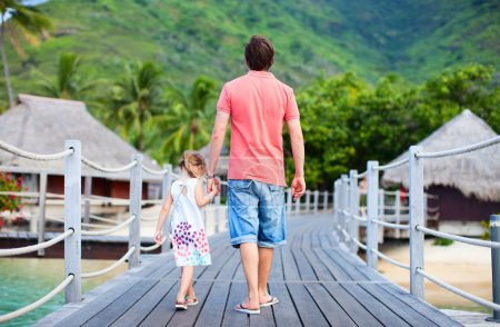 Father and daughter at tropical resort