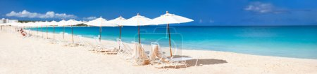 Chairs and umbrellas on a beautiful Caribbean beac...