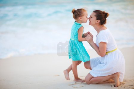 Photo for Mother and daughter enjoying time at tropical beach - Royalty Free Image