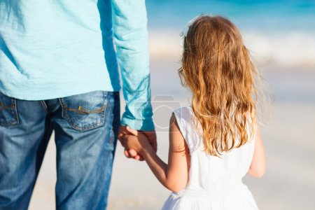 Photo for Adorable little girl holding her father hand - Royalty Free Image