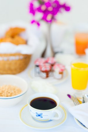 Photo for Fresh coffee, orange juice and fruit salad served for breakfast - Royalty Free Image