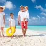 Family on a tropical beach vacation