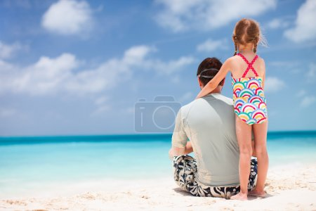 Photo for Back view of father and daughter enjoying beach vacation - Royalty Free Image
