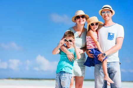 Photo for Happy beautiful family posing at beach during summer vacation - Royalty Free Image