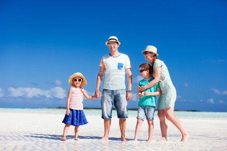 Photo for Happy beautiful family on a beach during summer vacation - Royalty Free Image