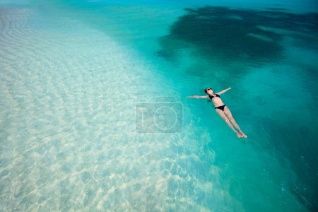 Woman swimming in ocean
