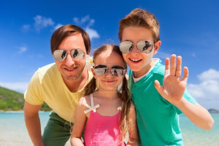 Photo for Father and kids at tropical beach vacation having fun outdoors - Royalty Free Image