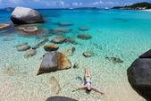 Woman swimming in tropical ocean