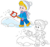 Little girl or boy removes snow with a small red shovel