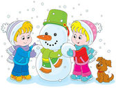Little girl and boy make a funny snowman with a bucket and scarf