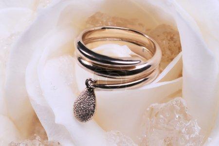 wedding ring on rose petal