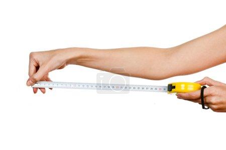 Photo pour Ruban à mesurer en main - image libre de droit