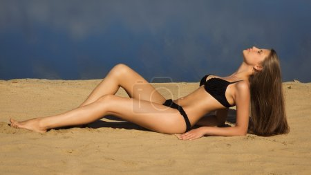 Attractive girl relaxing on a sandy beach