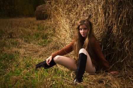 Portrait of beautiful young woman in countryside...