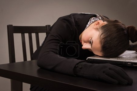 Photo for Detective scene imitation. Lifeless woman in a black suit sitting on a table - Royalty Free Image