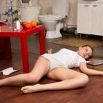Crime scene simulation: overdosed victim lying on the floor
