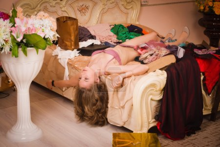 Lifeless woman in a luxurious lingerie lying on the bed