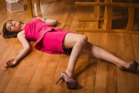Photo for Crime scene simulation. Lifeless woman in a luxurious interior - Royalty Free Image