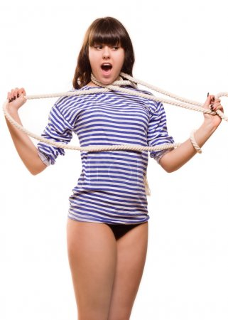 Beautiful woman sailor in pinup style strangles herself