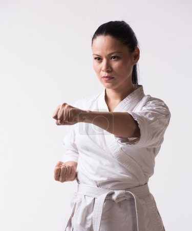 Woman show punch in martial art exercise