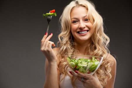 Photo for Happy healthy woman with salad - Royalty Free Image