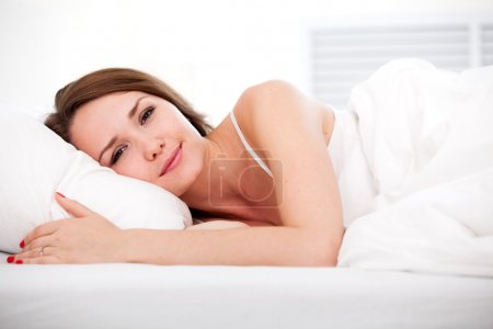 Woman in bed open eyes
