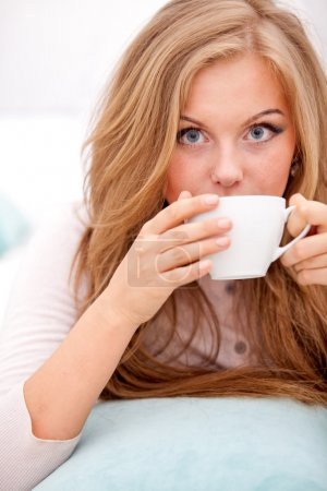 Woman drinking coffee, tea