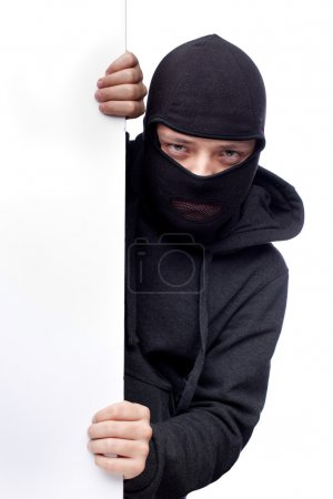Robber hiding behind a empty white space for text