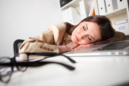 woman sleeps with computer