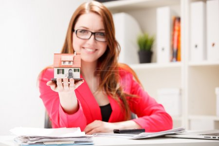 Photo for Little house toy in woman's hands - Royalty Free Image